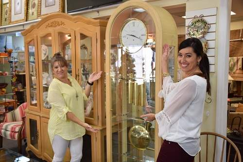Ladies smiling in front of clock